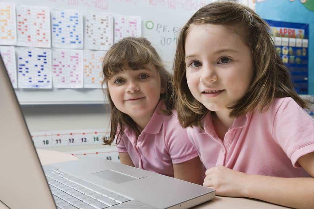 Little girls using a laptop
